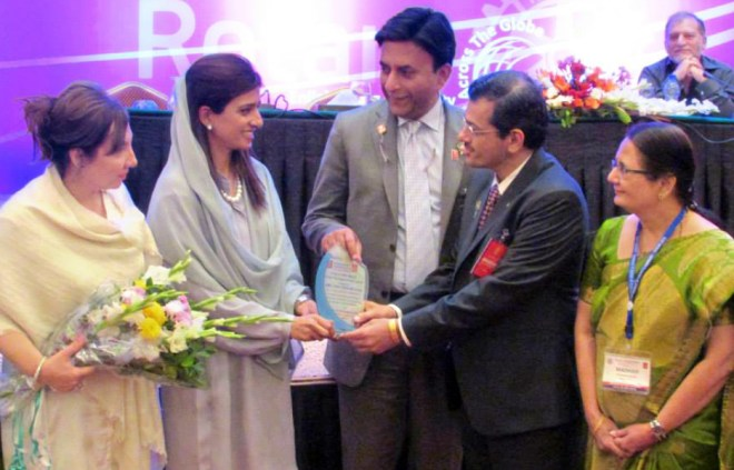 Dr Bharat Pandya, as RIPR, at District 3272 Conference, presenting an award to Hina Rabbani Khar, Pakistan's Foreign Minister. Madhavi is on his right.