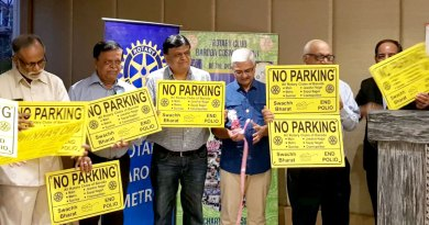 Rotarians display the No Parking boards.
