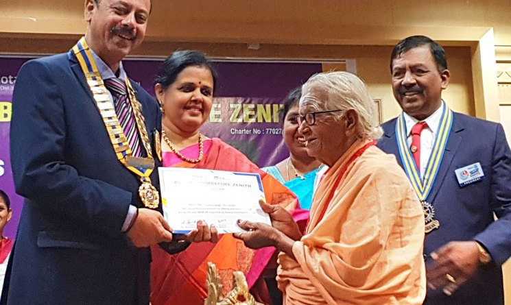 DG A V Pathy and spouse Veena giving the certificate to the nonagenarian Kulandhaiammal. Also seen is RC Coimbatore Zenith President Raviraj Krishnan (right).