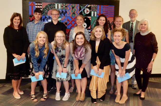 The recipients of the 2019 Rotary Club of Estes Park Scholarships at the awards programme along with the Rotarians.