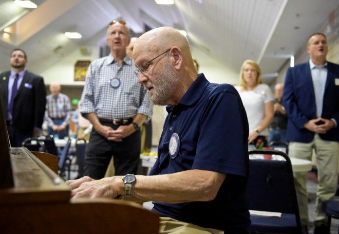 "Dale Sherrod plays ""America the Beautiful"" on the piano at the start of the Longmont Rotary meeting Tuesday at First Evangelical Lutheran Church."