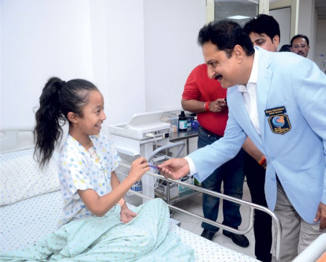 PDG Vinay Bhatia interacting with a child at the hospital.