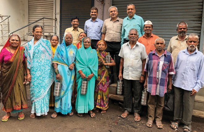 Rotarians of RC Solapur with the elderly beneficiaries of the tiffin-meal project.