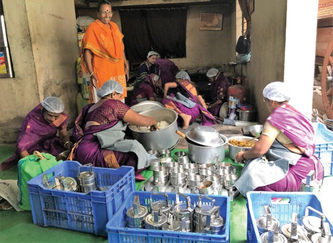 Chandrika Chauhan of the NGO Udyog Vardhini oversees her team preparing food for the Rotary Annapurna Yojana project.