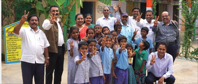 RC Bangalore Orchards past president D Ravishankar (second from right) along with K S Govindaraj to his left, Happy Schools Project Chair Prakash Hegde (second from left), Ramesh Chari (centre) and Neil Michael Joseph (kneeling) at the Government Higher Primary School at Ithandahalli village in Kolar district.