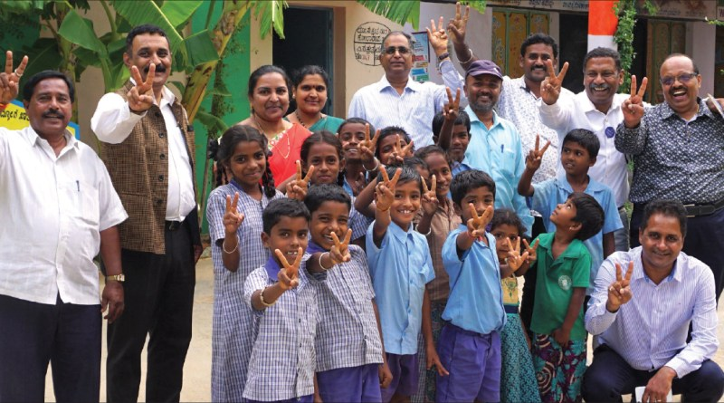 RC Bangalore Orchards past president D Ravishankar (second from right) along with KS Govindaraj to his left, Happy Schools Project Chair Prakash Hegde (second from left), Ramesh Chari (centre) and Neil Michael Joseph (kneeling) at the Government Higher Primary School at Ithandahalli village in Kolar district.