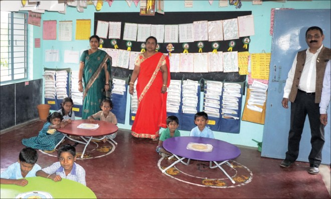 Project Chair Prakash Hegde (right) at a Nali Kali classroom.