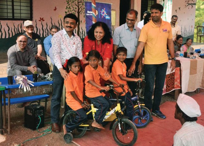 Bicycles being given to girl children at Darewadi village.