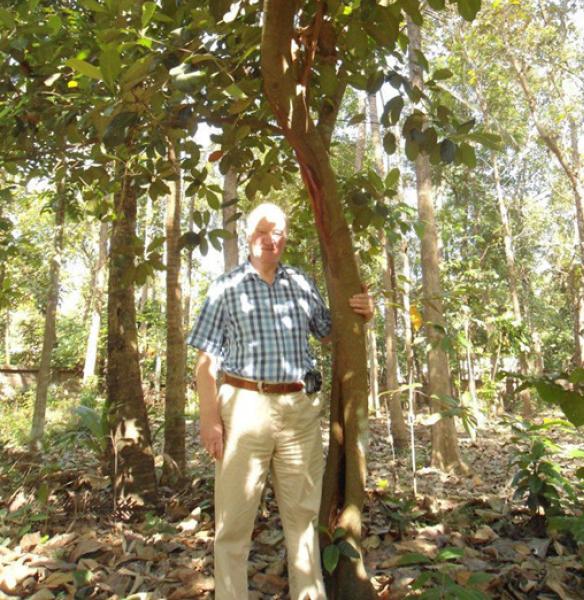 PDG John Wilton under the jackfruit tree that he had planted.