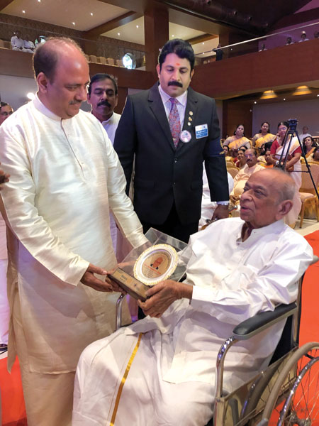 RIPN Mehta honouring PDG M Ramaswamy Iyer for his completion of 50 years in Rotary.