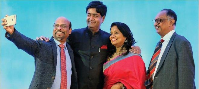 PDGs R Reghunath and Sunil Zacharia (RID 3211) with RIDN Venkatesh and Vinita.