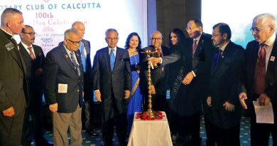 PP S K Sharma lights the lamp in the presence of PDG Somendra Chandra Nandy (third from L), David Palmer (RID 1130), PRIP Rajendra Saboo, RC Calcutta Secretary Anusua Das, Club President Purnendu Roy Choudhury, PP Nilima Joshi, RID Bharat Pandya and Centenial Committee Chairman Saumen Ray.