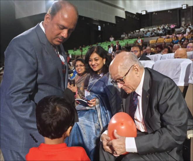 PRIP Kalyan Banerjee interacts with a young polio survivor as RIPN Mehta, Sonal and Rashi look on.