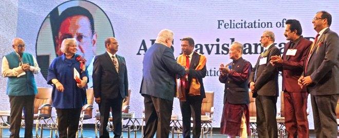 RI President Mark Maloney felicitates D Ravishankar, Past President, RC Bangalore Orchards, in the presence of (from L) PRIP Kalyan Banerjee, Gay, RIPN Mehta, TRF Trustee Chair Gary Huang, PDGs Suresh Hari, John Daniel and DG Deepak Gupta.