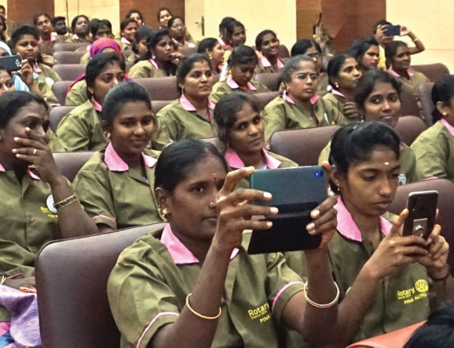 Women auto drivers all excited to receive their licence and badge.
