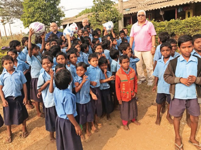 RC Calcutta President Purnendhu Roy Chowdhury (far left) and Centennial Committee Chairman Saumen Ray (R) with tribal children of Santhali in Purulia. A boarding school is being built here by the club to accommodate 400 young students.