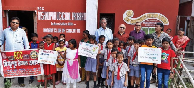 Club President Chowdhury with club members at a school in Bishnupur where new classrooms were constructed.