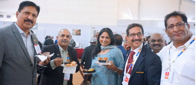 From L: Centennial Summit Secretary Kishore Kumar Ch, PDG Tikku, Shobha Kishore, and DG M Veerabhadra Reddy enjoying the food at the HoF food court.