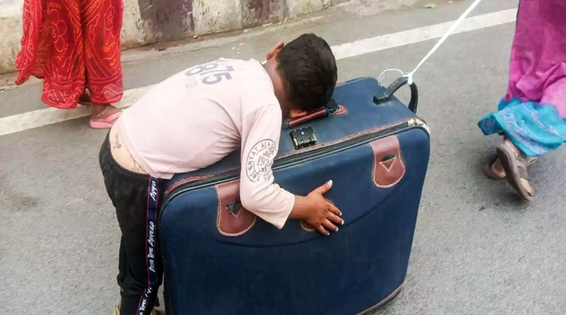 The gut-wrenching image of a tired child sleeping on a suitcase dragged by his mother, a migrant worker, making on foot a long and arduous journey back home.