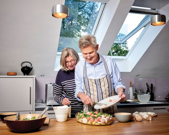 President Knaack and Susanne love to cook for themselves and their friends; here, they assemble a meal in his sister's kitchen.