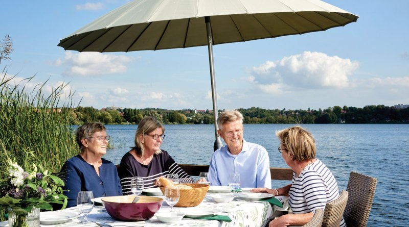The Küchensee, one of Ratzeburg's four lakes, provides a scenic backdrop for lunch with President Knaack's sister, Barbara (left), and Susanne's sister, Sabine (right).