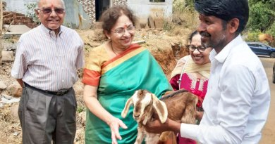 PDG Meena Patel, RID 6650, along with her husband Indu Patel, hands over a goat to a beneficiary.