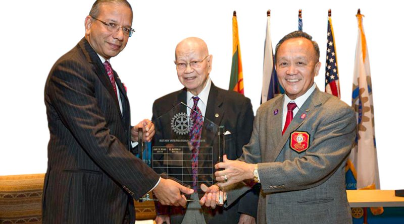 In the RI Presidential changeover ceremony on June 30, 2015, at the Rotary headquarters in Evanston, officiated by PRIP Mat Caparas (centre),  K R Ravindran (L) takes charge from Gary Huang.