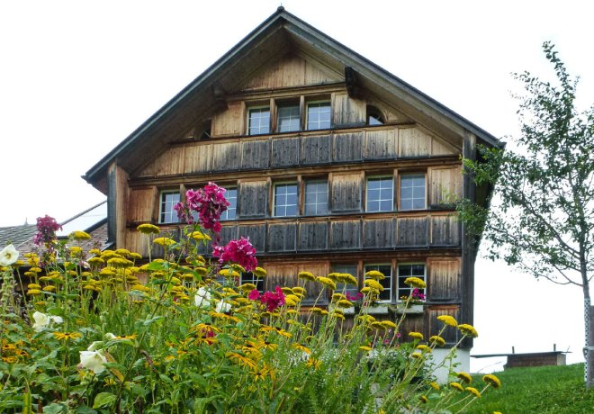 A typical farmhouse in a Swiss countryside.