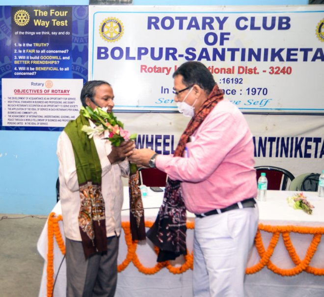 Tree cutter College Bagdi being honoured by past district secretary Subir Roy.