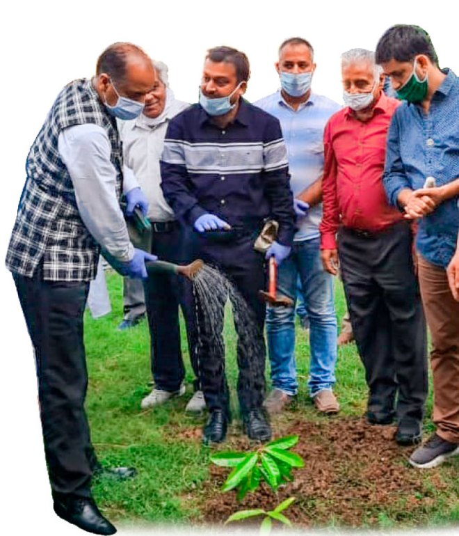 Himachal Pradesh chief minister Jai Ram Thakur watering a plant at the secretariat under RC Kangra's environment project.