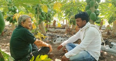 Mayank Gandhi with a farmer.