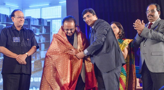 Rtn Surendran Menon, a singer himself, honours SPB who sang at a fundraiser of RC Madras South in 2013. PRID PT Prabhakar and PDG ISAK Nazar are also in the picture.