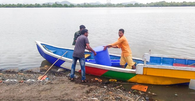 A boat used to ferry a handwash facility to a school defying the floods.