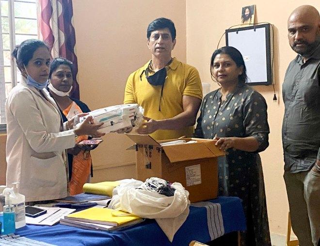 Rotary Bangalore Brigades president Ashwani Kinger donates medicines to the AiR Humanitarian Home.