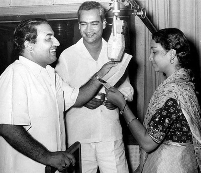 During a recording session with Mohammed Rafi and music composer OP Nayyar (centre).