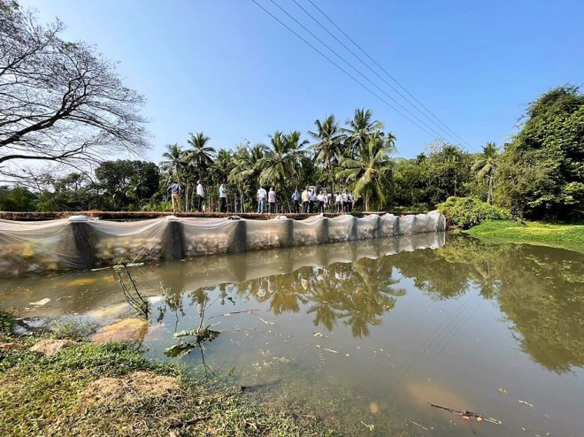 A check dam built with environmental-friendly material across a catchment area.
