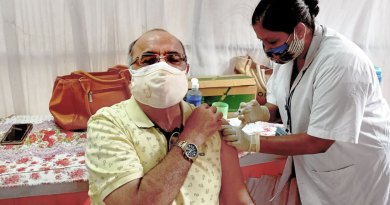 Covid vaccine being administered at a vaccination centre set up by Rotary.