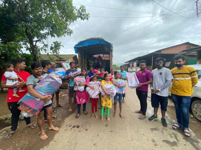 Flood-affected-people-who-have-received-our-support.-In-picture-are-also-our-Rotaractors-who-visited-the-site