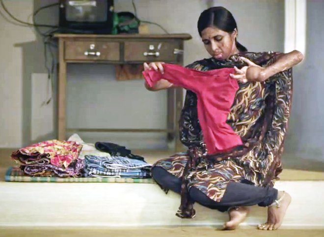 Thilagavathy, a beneficiary of Hope after Fire, is now able to lead a near-normal life, participating in household chores and helping her husband in his weaving activities