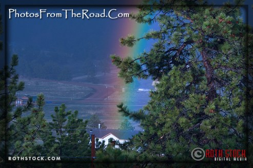 Rainbows form in the evening light in the Rocky Mountains of Colorado.