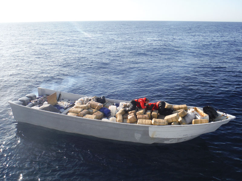 U.S. Coast Guardsmen assigned to the coastal patrol boat USCGC Haddock count bales of marijuana aboard a seized panga in the Pacific Ocean off the coast of southern California.