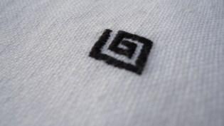 Black Arty detail on napkin white linen