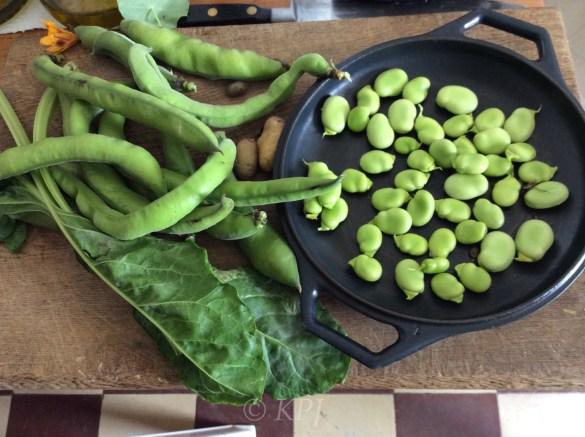 Beans, spinach, nasturtium flower and a few rogue tatties