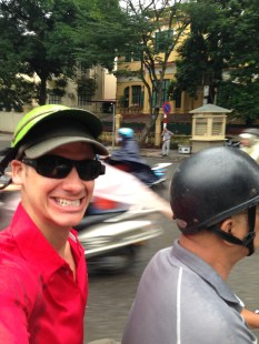 Jon taking motorbike to sites - quite a ride through the Hanoi streets!