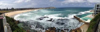 Bondi beach on the left with salt water pools on the right
