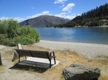Memorial bench of Jen's friend's late husband on the bike path of Lake Wanaka . It was special for us to visit the bench!
