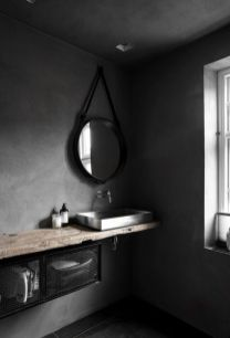 Dark moody bathroom designs that impress (12)