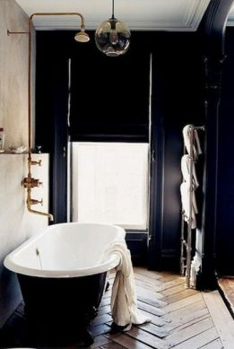 Dark moody bathroom designs that impress (17)