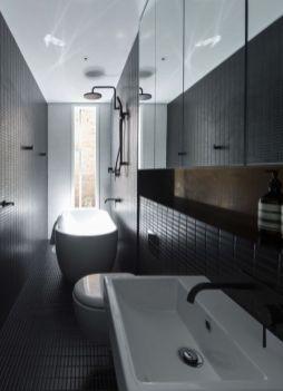 Dark moody bathroom designs that impress (18)