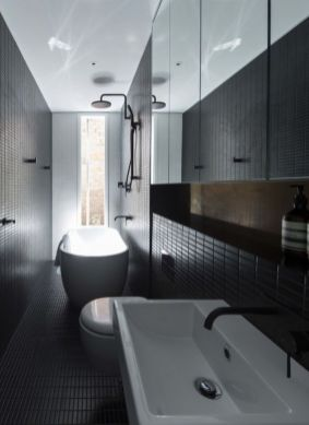 Dark moody bathroom designs that impress (18)